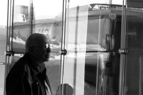 Old man waiting for bus